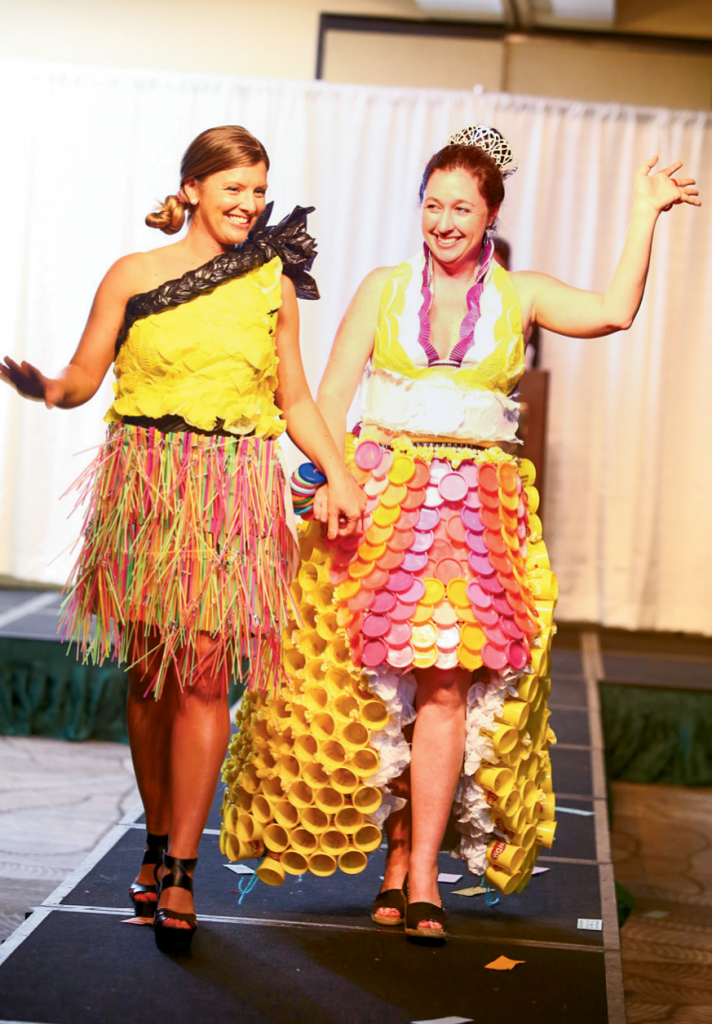 Most Creative Description  Designers: Ashleigh Justice of Surf Signs and Designs and Darcy Jones, first grade teacher at Seaside Elementary  Sponsoring company: Seaside Elementary  Models: Seaside Principal Krissy Dowling and Seaside Vice Principal Samantha Wood  Description of outfit: The materials used to make these designs include more than 350 Playdoh containers, tissue paper, string, trash bags, cupcake liners, straws, drink stirrers, duct tape, rubber cement, safety pins and more hot glue than they care to remember.