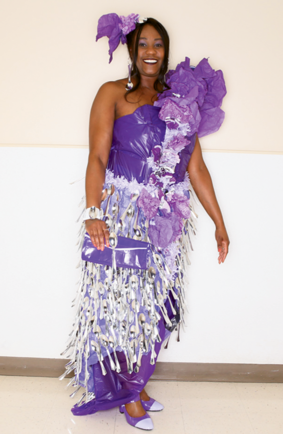 Most Intricate Design  Designer: Christopher Rogers  Sponsoring company: Christophe' and Co. of Blue Cross Blue Shield of SC  Model: Marcie Bass  Description of outfit: The materials used to create this fashion include paper baking cups, party decorations, tissue paper, paper doilies, aluminum foil, duct tape, wire and plastic spoons.
