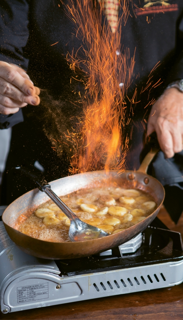 Fired Up: The Bananas Foster dessert, flamed tableside, is the essence of dinner theater.