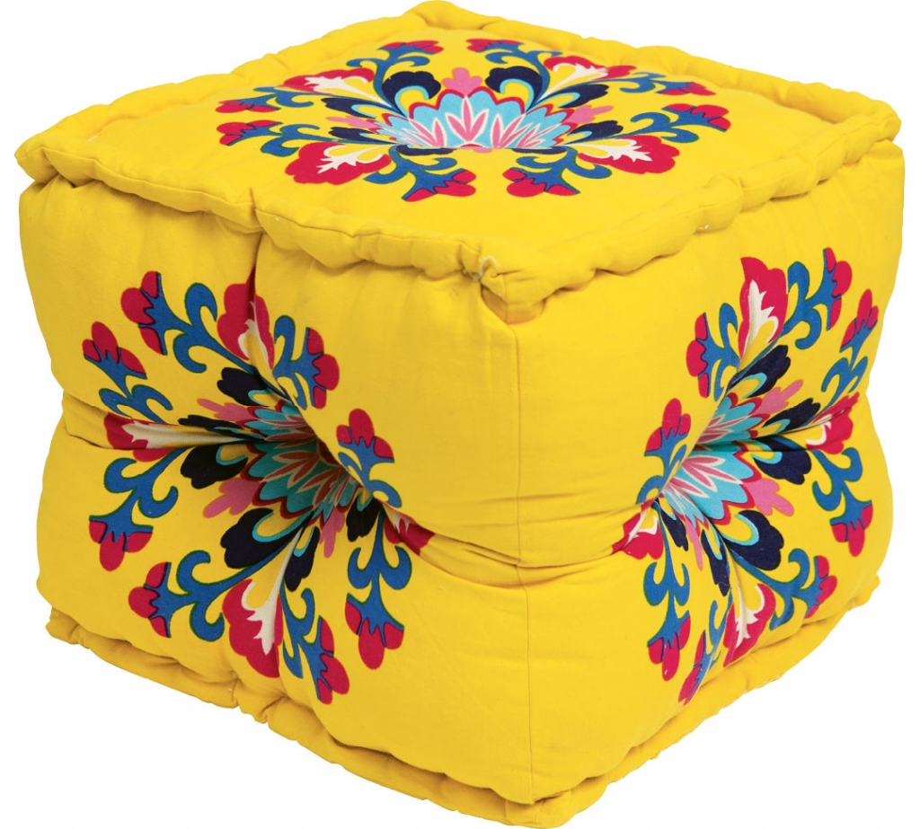 Add some spice to your room with this brightly colored Morroccan-inspired triangular pouf.
