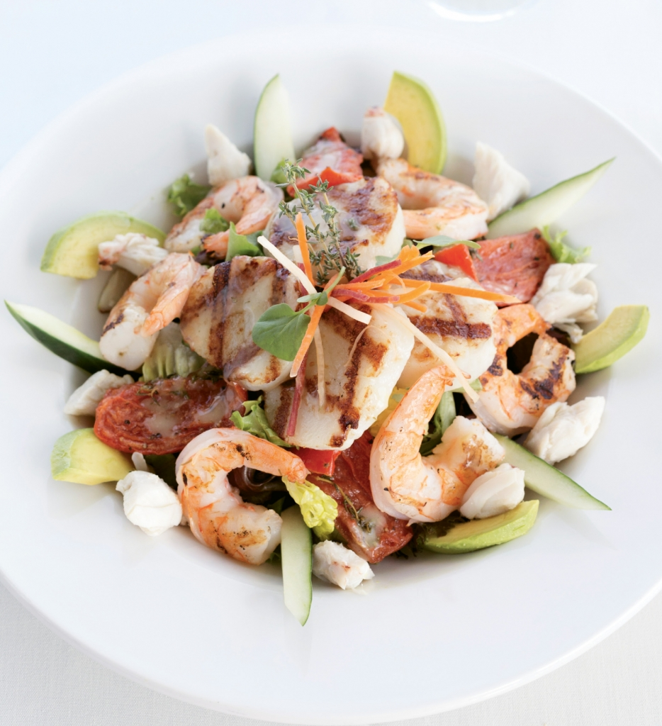 Green Plate Special: The Grilled Seafood Salad at Austin's is a toss up of shrimp, scallops and crab served over baby greens with fresh avocado and roasted tomatoes. A lemon herb vinaigrette dresses the dish perfectly.