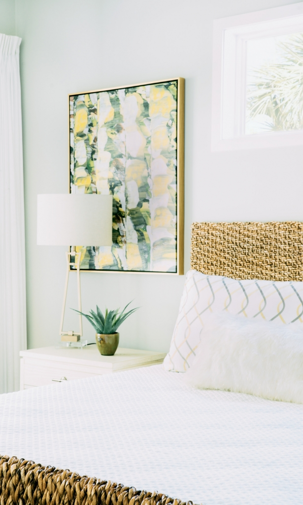 One of the master suites in the house combines a grey and yellow color scheme with natural bamboo pieces.