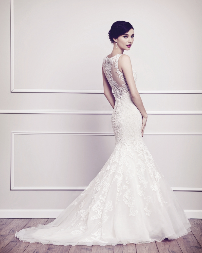 kenneth winston Fit and flare silhouette gown covered in soft cotton lace from the bateau neckline to hem and paired with intricate beadwork.  Style 1565. Amanda's Collection, $1,583