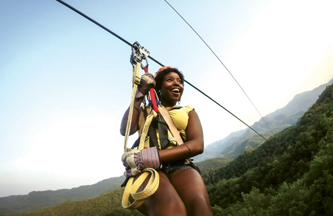 Take your breath away with a zipline tour at the Nantahala Outdoor Center, pictured above. Or take in the breathtaking views from a car aboard the Great Smoky Mountains Railroad.