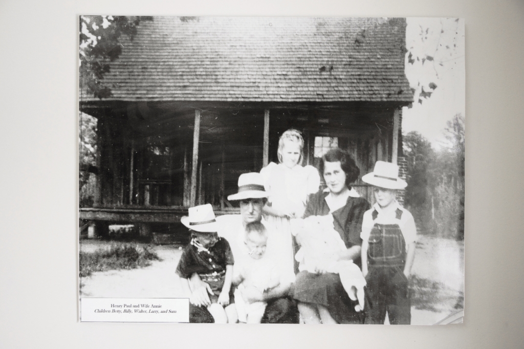 The Paul family in front of the family farmhouse, a replica of which may be found at the L.W. Paul Living History Farm.