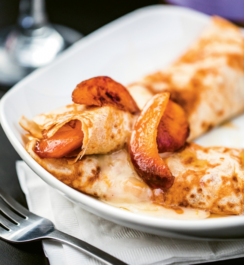 Pluck A Peach: Pairing caramelized peaches with creamy warm Brie and finishing with a drizzle of honey makes for a light and dreamy crepe.