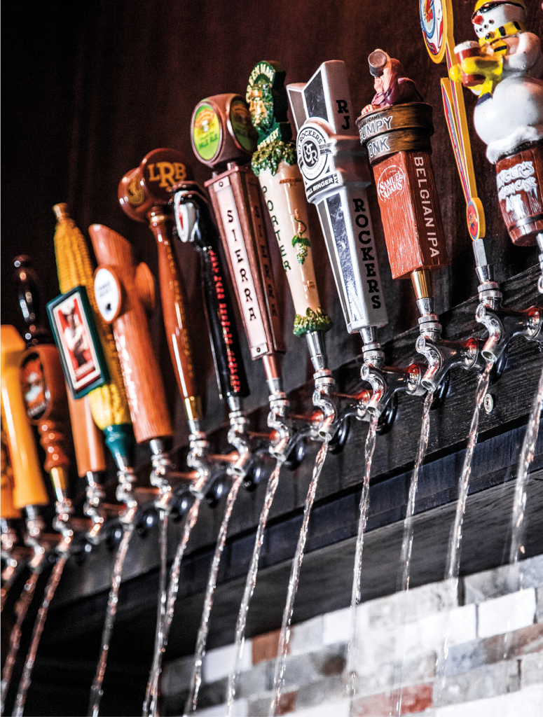 The Grumpy Monk's entrance features a 20-tap faux beer waterfall.