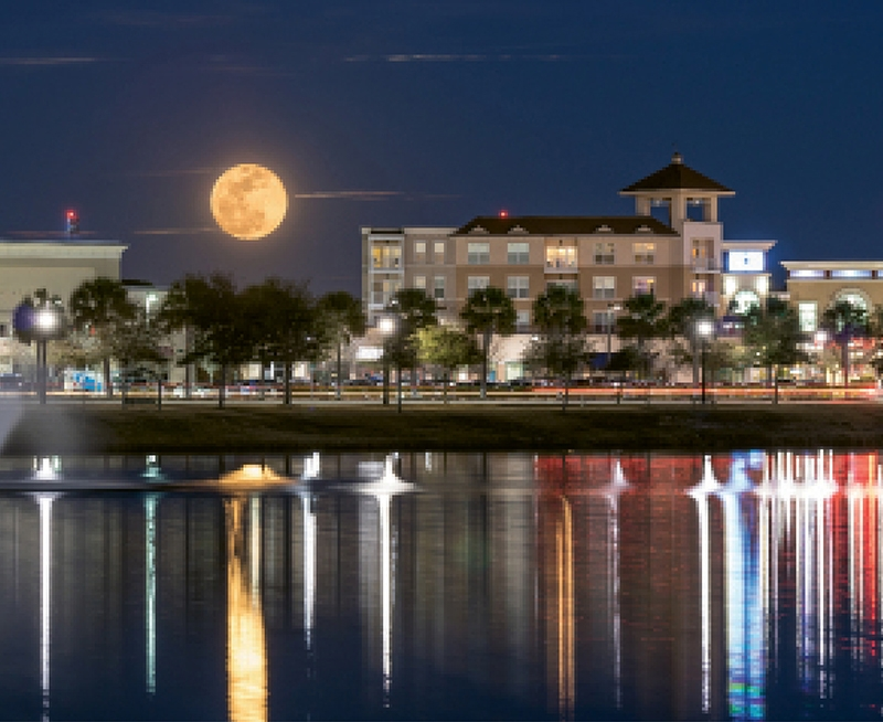 SUPER MOON OVER MARKET COMMON: Chuck Lawhon submitted this photo in our Images of the Grand Strand photo contest. We loved it so much, we used it with this article