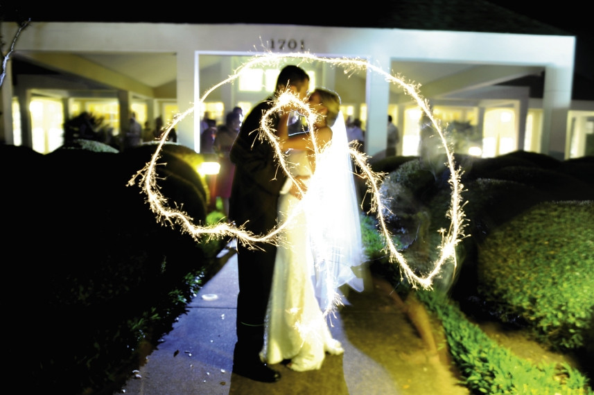 Little details were noted in placement of wedding gifts and cards, sparklers during the couple's exit and the printed materials for the wedding.