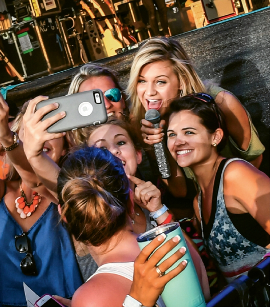 Fan grab selfies with Kelsea Ballerini at the 2016 festival.