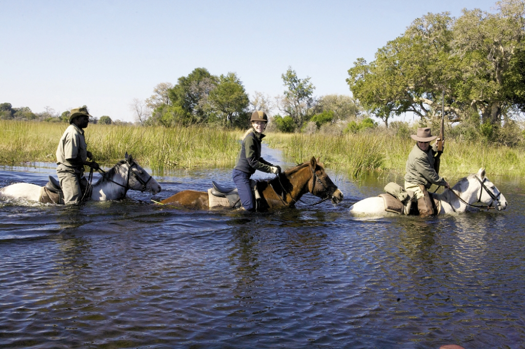 "Delta Darley: Guide John Sobey, Darley Newman and crew ride the Okavango Delta in Botswana, Africa, on an episode of ""Equitrekking."""