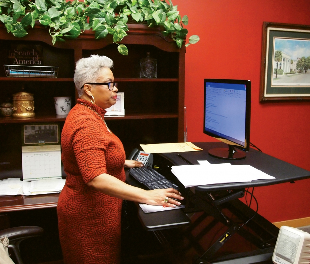 At her desk in her chambers, Judge Wilson answers the day's emails.