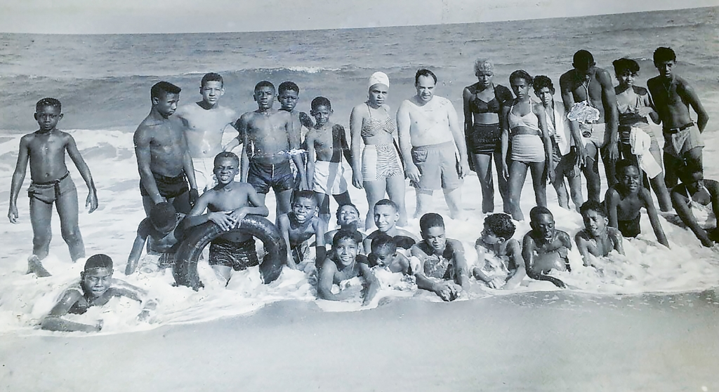 Counselors and campers from nearby Camp Baskerville of Holy Cross Faith Memorial Episcopal Church visiting McKenzie Beach in 1950.Walter Manigault Jr. is pictured third from the right in the bottom row.