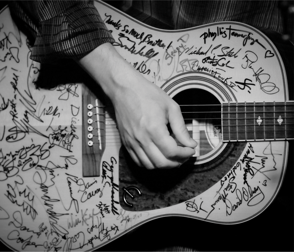 "Lousiana songwriter Kevin Gordon performs with the ""SXSE Guitar"" on August 14, 2010. The guitar has been signed by many of the musicians that have performed at the series."