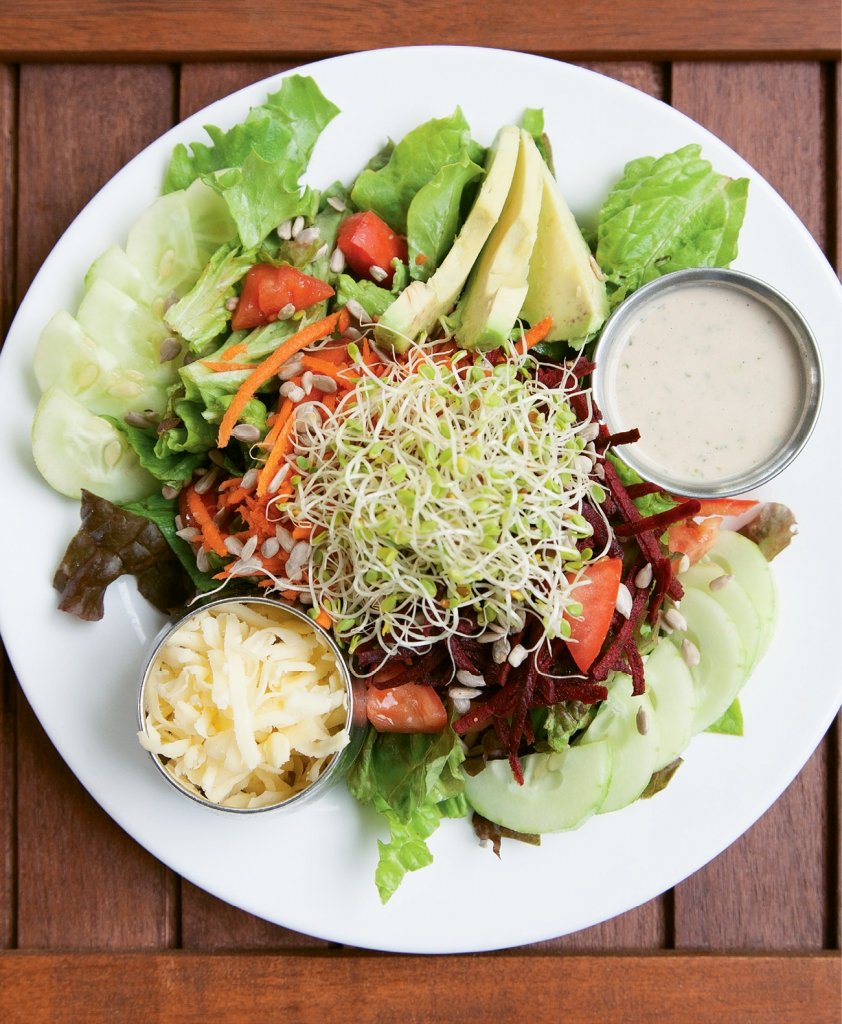 Bay Naturals has several salads on the menu, including the Bay Chef Salad with organic mixed lettuces, organic carrots, tomatoes, clover sprouts, avocado and more.