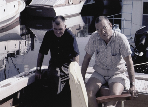 "Captain ""Biddy"" Alderman and Dinks Fitzgerald in the cockpit of the sport fisherman."