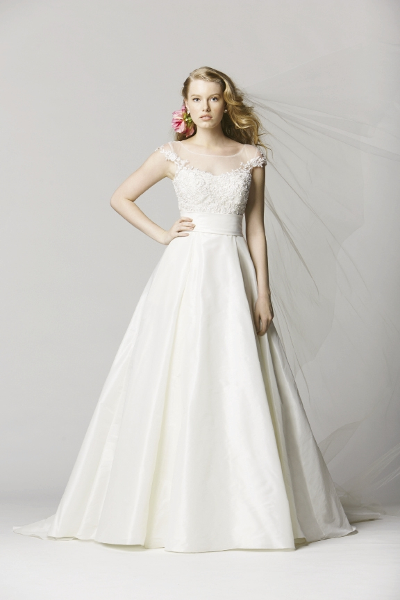 WTOO BY WATTERS: The Toscana features a sheer silk illusion jewel neckline with beaded lace motifs and a softly pleated A-line shimmer taffeta skirt. The Little White Dress, $1,518