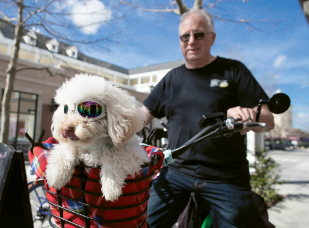 Ron Campbell and his dog, Darcy, enjoy a warm February day at The Market Common.