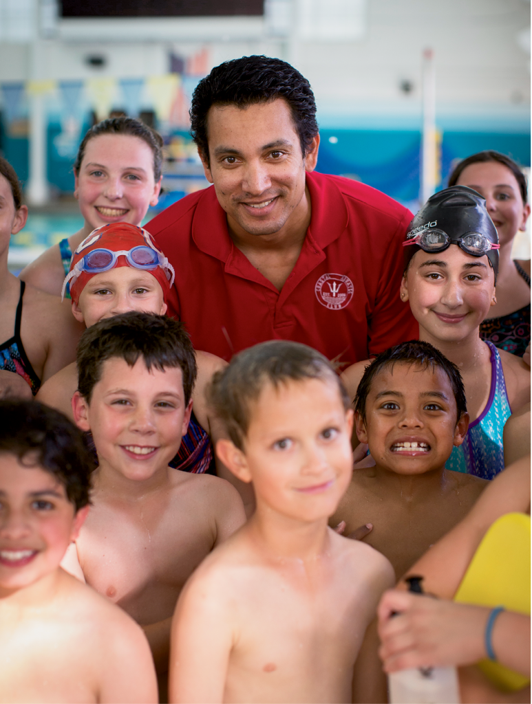 Coach Fabio Silva leads by example for the 100 swimmers on the Coastal Aquatic Club swim team.