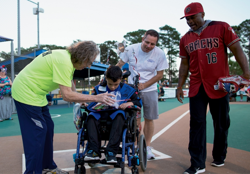 Howie Weinberg greets Miracle League players during a recent game in Myrtle Beach.