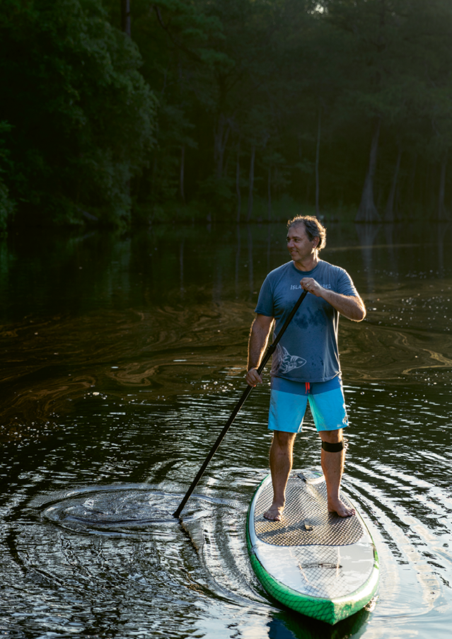 Todd Sutz eyes the tannin-stained blackwater of the Waccamaw River.