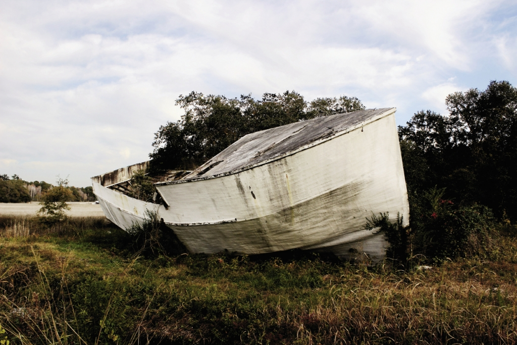 Washed Ashore: The shell of a shrimp trawler that was left high and dry in McClellanville by Hurricane Hugo in 1989