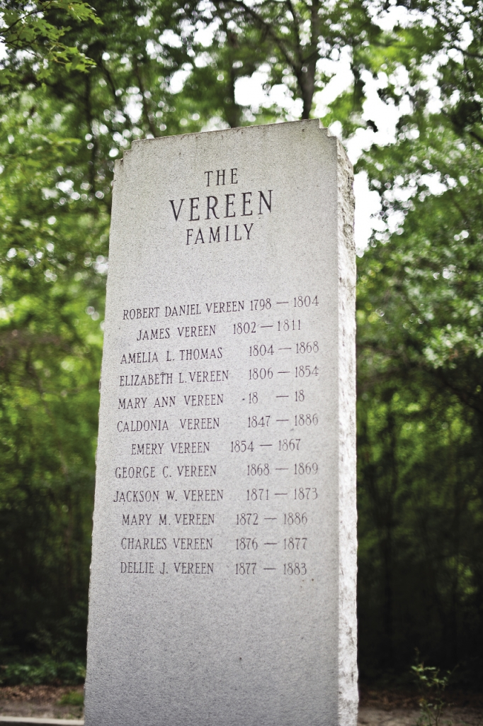 A white marble statue details the Vereen family tree during the 1700s-1800s.