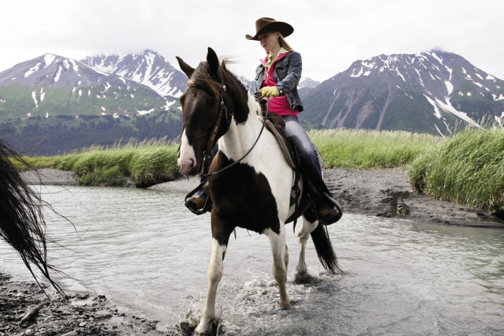 Through The Last Frontier: Newman rides a horse named Orca outside of Seward, Alaska.