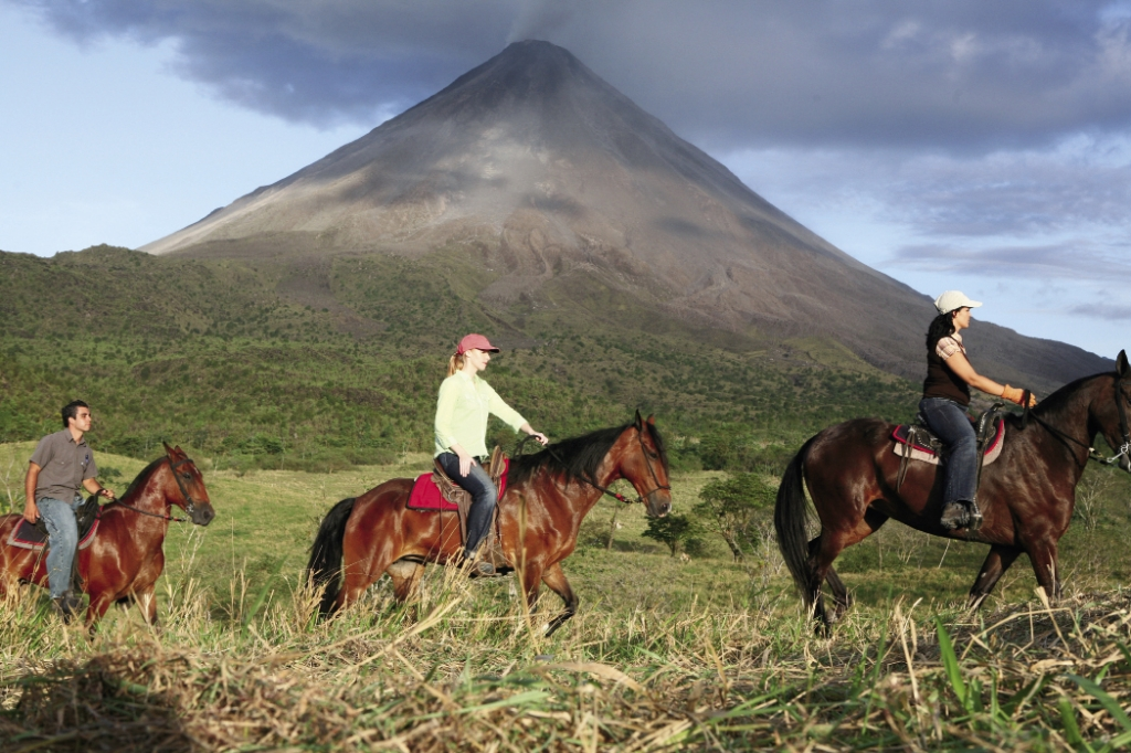 Newman rides the base of Arenal Volcano in Costa Rica.