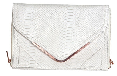 Web Extra: Brighten up your little black dress with this white snake skin envelope clutch from BCBG Generation. $88. Socialite, 3328 U.S. 17, Murrells Inlet. (843) 651-2317