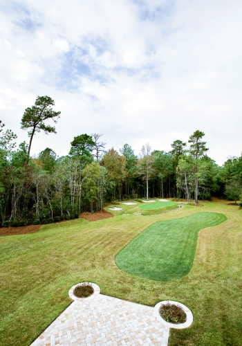 The backyard features a replica of the 13th hole at Augusta National Golf Club.