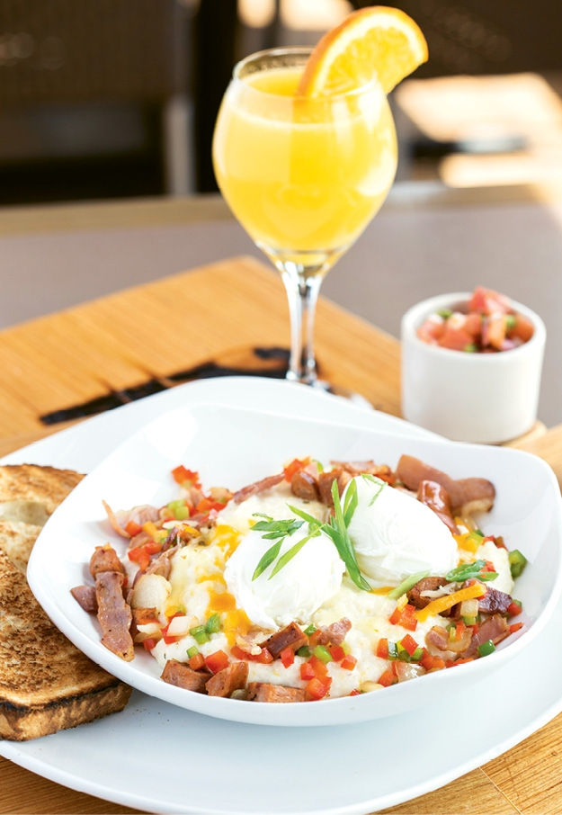 Try this on for a stick-to-your-ribs breakfast! The Garden City Grit Bowl layers country ham, andouille sausage, peppers, onions, eggs, pepper jack cheese and salsa over a bowl of creamy grits.