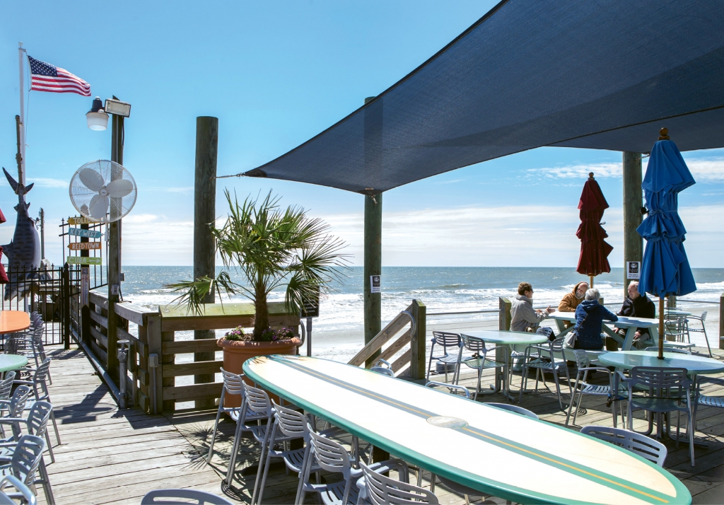 The Atlantic Ocean, a beachfront patio and the pier make for some of the best views and people-watching from a seat in the Surf Diner at Surfside Pier.