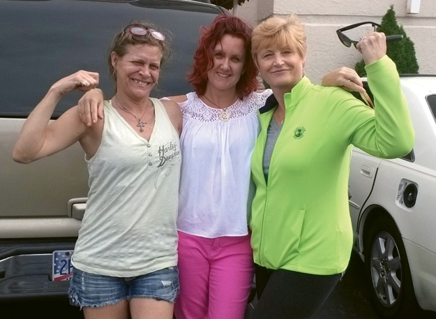 Volunteers Suzanne Brown, Sheri Miller and Cheryl Tuckerman celebrating after Astrid was found