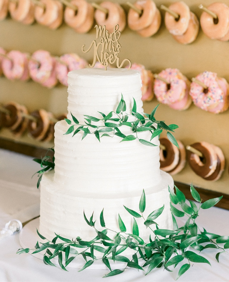 Jeff, who owns his own construction company, built many components of the wedding day decor himself, including the doughnut wall adorned with Krispy Kreme offerings. There were also treats from Ben & Jerry's, as well as a pretty white cake created by Cakes by the Sea.