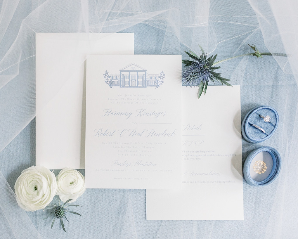 As a graphic designer, Harmony sketched her venue and incorporated the drawing on her invitations, bridal party gifts and koozies.