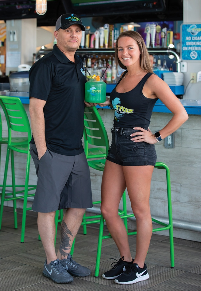 Joe Howe, general manager of RipTydz Oceanfront Grille & Rooftop Bar Restaurant in Myrtle Beach, poses with bartender Michelle Rawlyk.