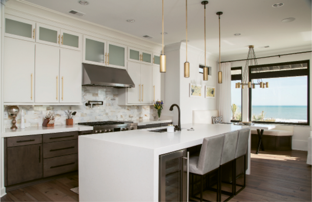 Quiet custom features that make a profound statement are quoted in elements like three-inch-thick white quartz countertops, the waterfall kitchen island, a built-in banquette and a completely tiled oceanfront pool.