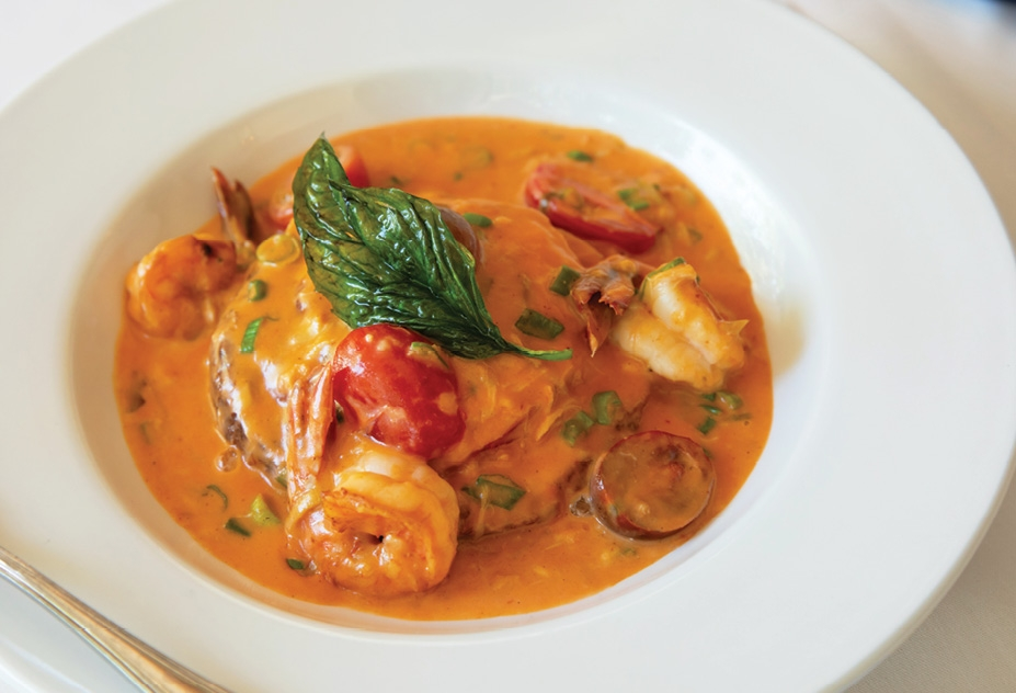 Chive Blossom's individual tomato pie with cherry heirloom tomatoes, shrimp and sherry cream sauce with fried basil garnish.