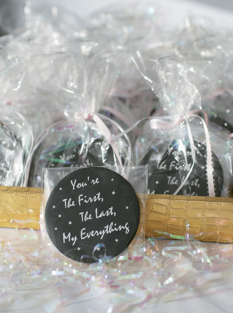 Personal Touch: Wedding favors were slate coasters from Caroline's uncles, who own a slate quarry in Pennsylvania that was founded by her late grandfather. Printed on each is a song title by Barry White.
