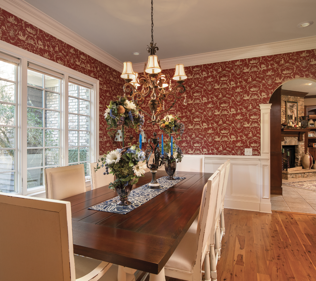 Pure Elegance: The rich, formal dining room is a setting fit for royalty, opening onto the home's cozy fireplace.