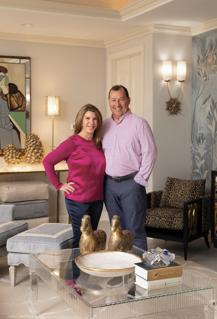 Shelyn and Gregg Lee stand proudly in their Grande Dunes home