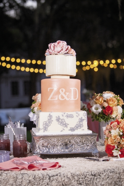 WHIMSICAL ROSES: Mikayla Phillips and Joseph Peter created this three-tier blueberry almond, red velvet and lemon berry cake with planner Gigi Noelle Events and  Buttercream Cakes & Catering.