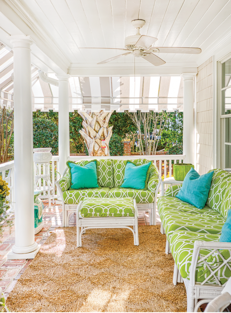 The DeBerrys' front porch catches the ocean breeze and captures the essence of coastal Southern charm.