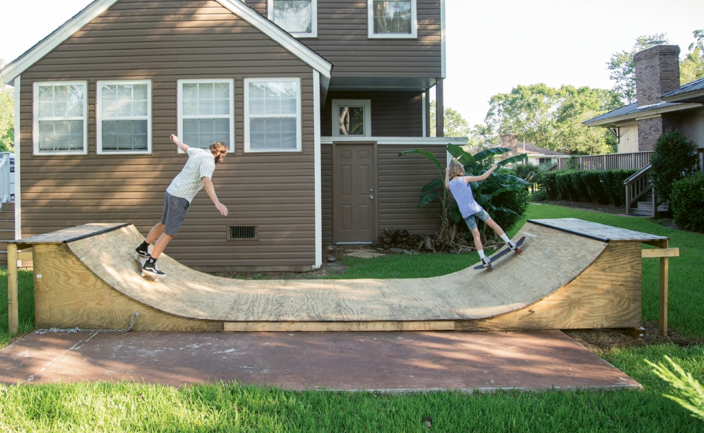 The Browns skate on the backyard mini-ramp.