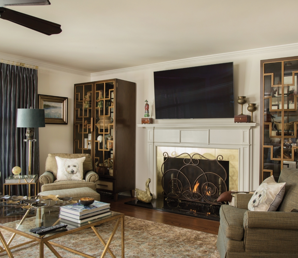 """Ansley's home is a reflection of those """"things she likes"""" and treasures, such as throw pillows printed with her dogs' doll faces in the great room"""