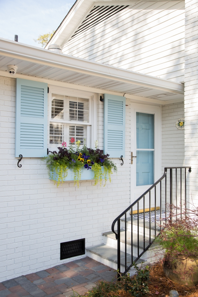 Both the front facade and back patio of this 1950s home were given a fresh coat of paint and a lot of love.