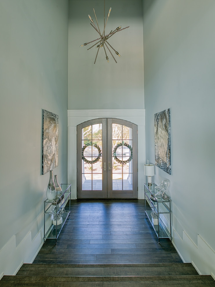 The impressive foyer sets the tone for the home's design