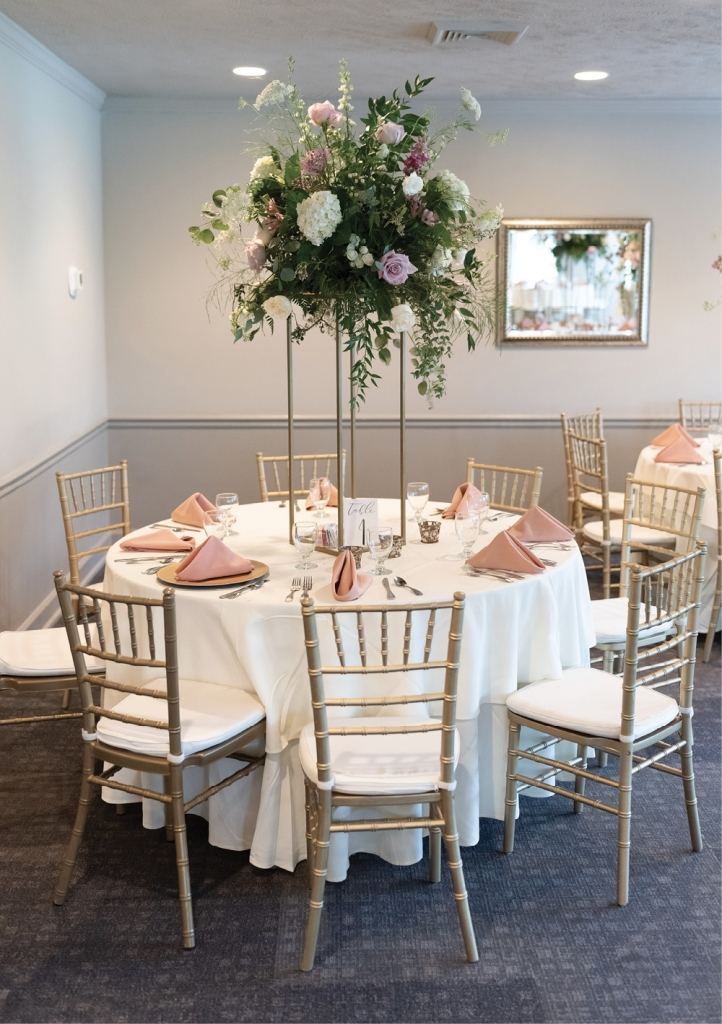 Gigi Noelle Events brought this dream to life. The colors were dusty rose, mauve, gold and navy, with flowers galore (even hanging from the chandeliers) and tall floral arrangements.