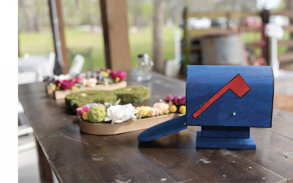 Since the pair used email and instant messenger to stay in touch back in the day, Jennifer painted an AOL wooden mailbox for cards and the groomsmen wore AIM lapel pins.